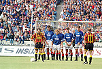 Chic Charnley prepares to lob a free-kick over the Rangers wall of Dave McPherson, Stuart McCall, Ian Ferguson, Brian Laudrup and Duncan Ferguson at Partick Thistle in August 94. Fans squeezed into Firhill and kids sitting on the wall, changed days indeed.