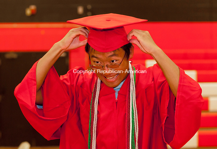 WATERBURY, CT-21 June 2013-062113BF06-  Greg Han, 18, adjusts his cap Friday during graduation at Cheshire High School in Cheshire. Bob Falcetti Republican-American