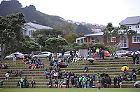 Fans watch from the terraces during the Wellington Club Rugby Swindale Shield match between Old Boys University and Wainuiomata at Nairnville Park, Wellington, New Zealand, on Saturday, 13 April 2013. Photo: Dave Lintott / lintottphoto.co.nz