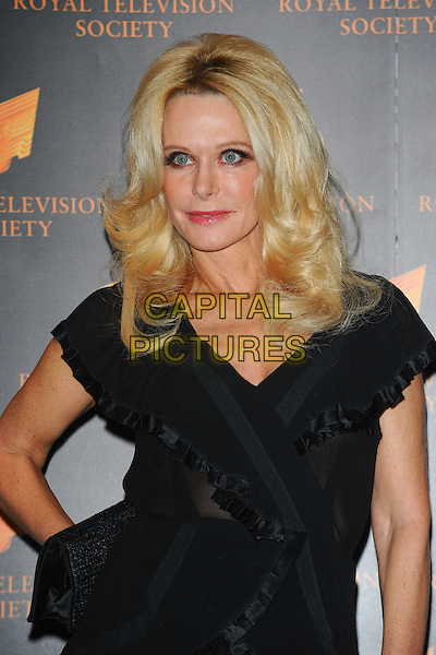 TRICIA WALSH-SMITH.The Royal Television Society (RTS) Awards, Grosvenor House Hotel, Park Lane, London, England, UK,.March 15th 2011..half length black dress hand on hip.CAP/CJ.©Chris Joseph/Capital Pictures.