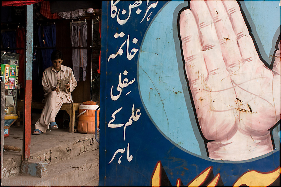 outside a palmist's shop in the old city of lahore