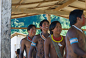 Pará State, Brazil. Aldeia Pukararankre (Kayapo). Singing and dancing in the warriors' house.