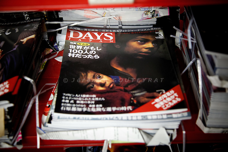 "Tokyo, June 10 2011 - Old issue of ""Days japan"" magazine in the sotck of the magazine. ""Days Japan"" is specialised in photojournalism."