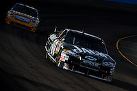 Nov. 9, 2008; Avondale, AZ, USA; NASCAR Sprint Cup Series driver Clint Bowyer leads Jamie McMurray during the Checker Auto Parts 500 at Phoenix International Raceway. Mandatory Credit: Mark J. Rebilas-