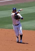 25th July 2020, Los Angeles, California, USA;  Los Angeles Dodgers Third base Justin Turner (10) makes a throw to first base during the game against the San Francisco Giants on July 25, 2020, at Dodger Stadium in Los Angeles, CA.