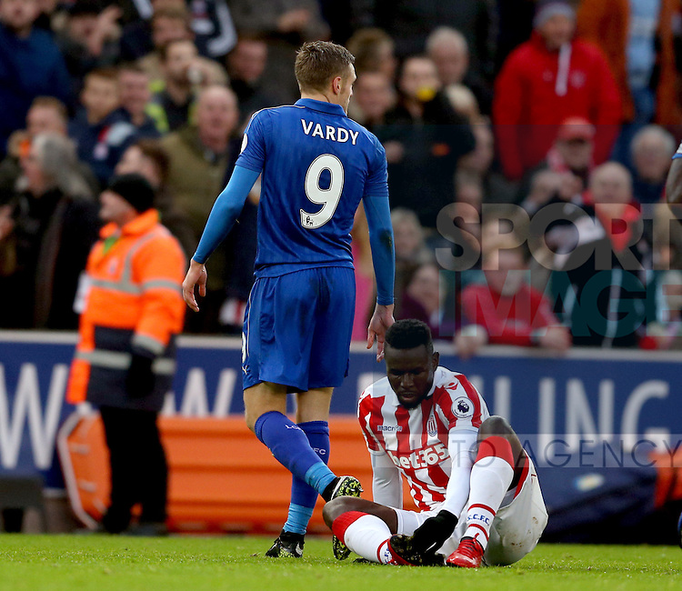 Jamie Vardy of Leicester City walks off after being red carded as Mame Biram Diouf of Stoke City sits on the floor during the English Premier League match at the Bet 365 Stadium, Stoke on Trent. Picture date: December 17th, 2016. Pic Simon Bellis/Sportimage