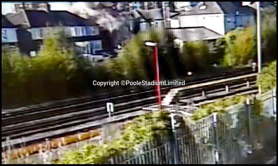 BNPS.co.uk (01202 558833)<br /> Pic:  PooleStadiumLimited/BNPS<br /> <br /> A still image from CCTV footage of the moment of the blast.<br /> <br /> A spurned husband who almost killed himself and his ex-wife when he deliberately blew up their house with them inside it is facing a lengthy jail term today.<br /> <br /> Ian Clowes appeared in court via a video link and pleaded guilty to a charge of arson in connection with the huge gas explosion that ripped apart the semi-detached property. <br /> <br /> The 67-year-old had divorced from his ex-wife Elaine and converted their marital home into two flats before he triggered the blast on October 22 last year.