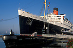 Russian Submarine and luxury passanger liner cruise ship hotel Queen Mary docked at Long Beach Harbor, California