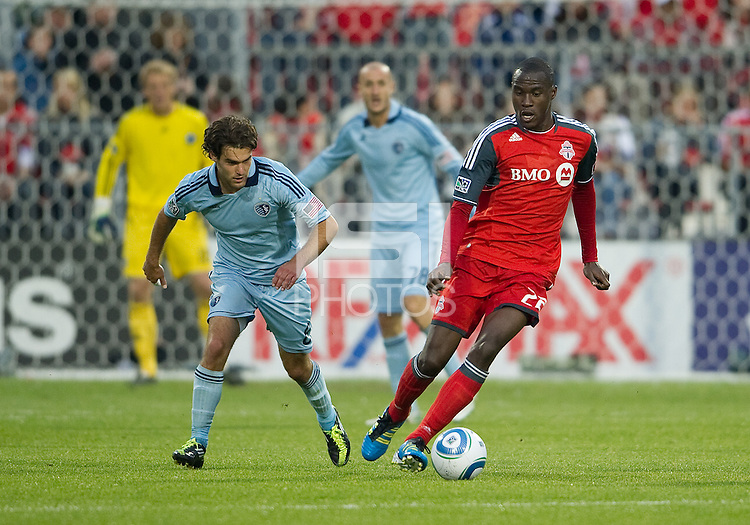 Sporting KC midfielder/forward Graham Zusi #8 and Torontoo FC midfielder Tony Tchani #22 in action during an MLS game between Sporting Kansas City and the Toronto FC at BMO Field in Toronto on June 4, 2011..The game ended in a 0-0 draw...