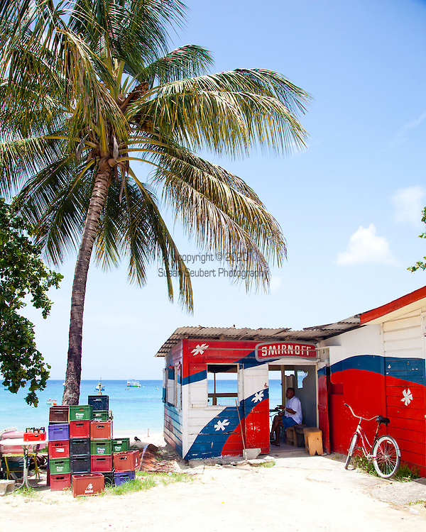 The John Moore Rum Shop located near Holetown on Barbados' Gold Coast has hosted everyone from neighborhood folk to movie stars to the Prime Minister.