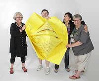 OrigamiUSA 2016 Convention at St. John's University, Queens, New York, USA. Oversized 9' x 9' paper folding event. First timers. Left to right: unknown, unknown, unknown, Sherry Moman, PA.