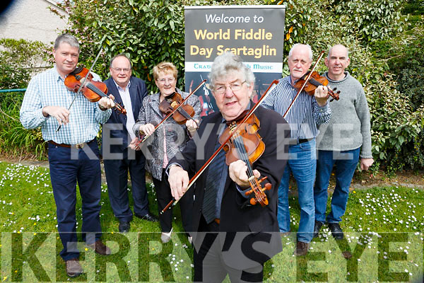 Nicky McAulliffe and l-r: Con Moynihan, tom Fleming, Anne McAulliffe, Matt Cranitch and Pj Teahan get into tune for World fiddle day which will be held in Scartaglen on Saturday