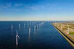 Nederland, Flevoland, Noordoostpolder, 28-02-2016; Westermeerdijk, ten noorden van Urk. Het grootste windmolenpark van Nederland, Windpark Noordoostpolder. De mega windmolens worden zowel op land als in het IJsselmeer gebouwd, in het water de fundamenten. Het windmolenpark van de Koepel Windenergie Noordoostpolder is een initiatief van NOP Agrowind, energiebedrijf RWE/Essent en Westermeerwind. <br /> he largest wind farm in the Netherlands, Wind farm Northeast Polder. On land and offshore in IJsselmeer.<br /> luchtfoto (toeslag op standard tarieven);<br /> aerial photo (additional fee required);<br /> copyright foto/photo Siebe Swart