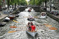 Nederland  amsterdam. Jaarlijkse Grachtenrace door Amsterdam. Wedstrijd met sloepen.  Foto Berlinda van Dam / Hollandse Hooogte.