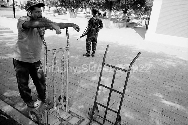 Linares, Mexico<br /> June 6, 2007<br /> <br /> The Mexican government has placed 30,000 military, primarily in the north of the country, to combat crime and drug trafficking. The military opens the &quot;food for weapons&quot; program in the small town of Linares. &quot;Arm yourself with values, not with weapons&quot; is the motto. Owning a weapon in Mexico is a crime. The military has been operating this program for the past few months and have collected about 1,000 weapons, including grenades.