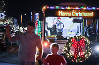 """NWA Democrat-Gazette/CHARLIE KAIJO Parade participants wave, Saturday, November 30, 2019 during an annual Christmas parade along Emma Ave. in Springdale.<br /> <br /> Floats, bands and Santa greeted visitors for the 23rd annual Christmas parade. This year's theme was """"Christmas Vacation"""". The parade started at Parsons Stadium and headed west on Emma Avenue, concluding at Harris Street."""