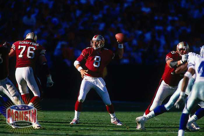 SAN FRANCISCO, CA - Quarterback Steve Young of the San Francisco 49ers in action during a game against the Dallas Cowboys at Candlestick Park in San Francisco, California in 1997. Photo by Brad Mangin..