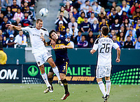 LA Galaxy defender Gregg Berhalter (17) defends against Boca Juniors forward Pablo Mouche (7). The LA Galaxy defeated Boca Juniors 1-0 at Home Depot Center stadium in Carson, California on Sunday May 23, 2010.  .