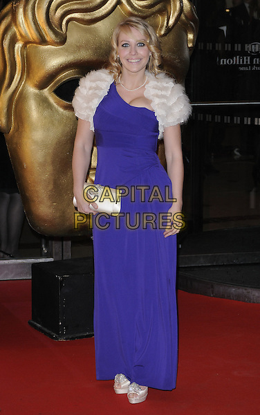LAURA HAMILTON.At the EA British Academy Children's Awards 2010, London Hilton Hotel, Park Lane, London, England, UK, .28th November 2010..full length purple dress one shoulder long maxi white cream fluffy shrug clutch bag.CAP/CAN.©Can Nguyen/Capital Pictures.