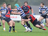26th October 2013; Sean O'Hagan, Corinthians, is tackled by Adam Griggs and Sam Cooke, Blackrock. Ulster Bank League Division 1B, Blackrock College v Corinthians, Stradbrook Road, Dublin. Picture credit: Tommy Grealy / Actionshots.ie