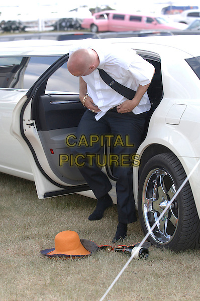 In the car park.Ladies' Day during the third day of Royal Ascot at the Ascot Racecourse.22nd June 2006 Ascot, Berkshire, England.Ref: FIN.full length funny limousine black trousers white shirt.www.capitalpictures.com.sales@capitalpictures.com.© Capital Pictures.