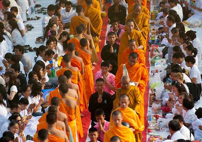 Bangkok, March 18, 2012, Grand scale alms offering event to commemorate the 2600 th year anniversary of the Lord Buddha's enlightment. Twenty thousand monks receive alms from devotees.
