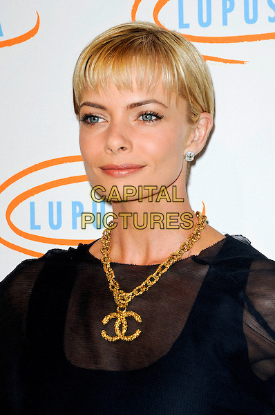JAIME PRESSLY.Lupus LA's 7th Annual Bag Ladies Luncheon to raise funds for lupus research at the Beverly Wilshire Four Seasons Hotel in Beverly Hills, California, USA..November 18th, 2009.headshot portrait Jamie Pressley black navy blue sheer gold chunky Chanel logo double c's necklace see through thru fringe.CAP/ROT.©Lee Roth/Capital Pictures
