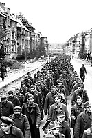 The endless procession of German prisoners captured with the fall of Aachen marching through the ruined city streets to captivity.  Germany, October 1944.  Associated Press Ltd.  (U.S. Occupation Headquarters)<br /> Exact Date Shot Unknown<br /> NARA FILE #:  260-MGG-1061-1<br /> WAR &amp; CONFLICT BOOK #:  1290