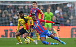 Crystal Palace's Wilfried Zaha and Arsenal's Ainsley Maitland-Niles challenge for the ball during the Premier League match at Selhurst Park, London. Picture date: 11th January 2020. Picture credit should read: Paul Terry/Sportimage