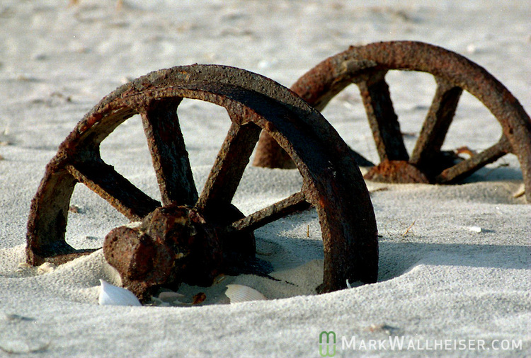 Old rail car wheels used to haul building and living supplies from the mainland side of the island one mile overland to the lighthouse and lighthouse keeper's home on the Gulf side of Little St. George Island.