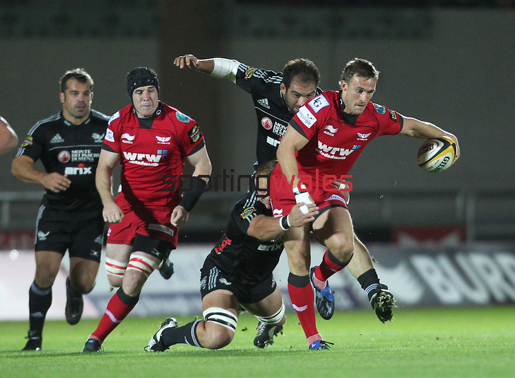 Andy Fenby gets caught up in the Aironi defence..Magners League.Scarlets v Aironi.Parc Y Scarlets.17.09.10.Photo Credit: Steve Pope-Sportingwales.
