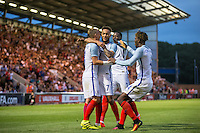 Lewis Baker (7)(Vitesse Arnhem, loan from Chelsea) of England celebrates his goal with teammates during the International EURO U21 QUALIFYING - GROUP 9 match between England U21 and Norway U21 at the Weston Homes Community Stadium, Colchester, England on 6 September 2016. Photo by Andy Rowland / PRiME Media Images.