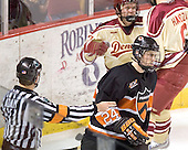 Max Cousins skates away as Patrick Mullen celebrates his goal with Mike Handza - The Princeton University Tigers defeated the University of Denver Pioneers 4-1 in their first game of the Denver Cup on Friday, December 30, 2005 at Magness Arena in Denver, CO.