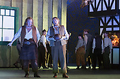 """London, UK. 30 January 2015. Nicky Spence as David and Iain Paterson as Hans Sachs. Richard Wagner's opera """"The Mastersingers of Nuremberg"""" (Die Meistersinger von Nuernberg) is performed live on stage during the dress rehearsal with English National Opera Music Director Edward Gardner leading the ENO Orchestra and Chorus. Directed by Richard Jones with with leads played by Gwyn Hughes Jones as Walter von Stolzing, Rachel Nicholls as Eva Pogner, Madeleine Shaw as Magdalene, Nicky Spence as David (Hans Sachs' apprentice), Iain Paterson as Hans Sachs, Andrew Shore as Sixtus Beckmesser and James Creswell as Veit Pogner. The opera will run for 8 performances at the London Coliseum from 7 February 2015. Photo: Bettina Strenske"""