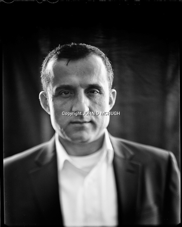 "Amrullah Saleh, former head of the Afghan intelligence service (NDS) and now political activist, is seen at his home in Kabul, 02 September 2012. This portrait was shot on a 5x4 Linhof Technika IV, circa 1959, and a Schneider Kreuznach 270mm lens, circa 1952, with front tilt, and is part of a series entitled ""Putting an Afghan face on the war."" (John D McHugh)"