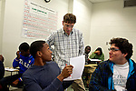 Greg Wahl, center, associate professor at Montgomery College, works with Ryan Holder, left, and Jose Torres, right, students in his Basic Writing II class, as they started working on their final project. If students pass this class, it allows them to progress to the college level english program. Otherwise students will face the decision to take the remedial class again or drop out.
