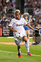 Fabio Coentrao (15) of Real Madrid]. Real Madrid defeated A. C. Milan 5-1 during a 2012 Herbalife World Football Challenge match at Yankee Stadium in New York, NY, on August 8, 2012.