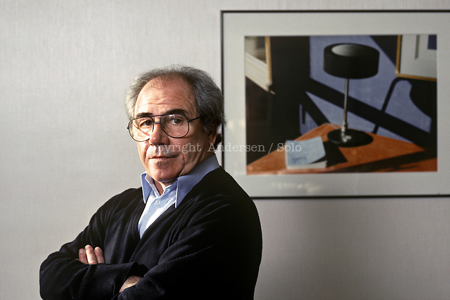 Jean Baudrillard at home in Paris, with in the background some of his own pictures.