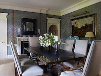 The colour scheme for the dining room is one of muted elegance