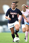 25 September 2011: Virginia's Olivia Brannon (5) is chased by North Carolina's Courtney Jones (behind). The University of Virginia Cavaliers defeated the University of North Carolina Tar Heels 1-0 in overtime at Fetzer Field in Chapel Hill, North Carolina in an NCAA Division I Women's Soccer game.