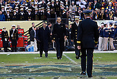 United States President Barack Obama, center, U.S. Secretary of Defense Leon Panetta, left, and Admiral Michael Miller, Superintendent of the Naval Academy, right, cross the field during half time to meet Lieutenant General David Huntoon, Superintendent of the U.S. Military Academy during the 112th Army-Navy Football game at FedEx Field in Landover, Maryland on Saturday, December 10, 2011. .Credit: Kristoffer Tripplaar  / Pool via CNP