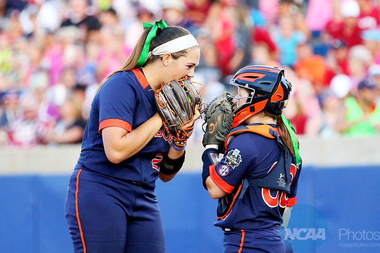 06 JUNE 2016: Lexi Davis (23) and Carlee Wallace (00) of Auburn University talk pitching strategy against University of Oklahoma during the Division I Women's Softball Championship held at ASA Hall of Fame Stadium in Oklahoma City, OK.  University of Oklahoma defeated Auburn University in Game 1 by the final score of 3-2. Shane Bevel/NCAA Photos