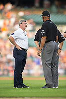 Detroit Tigers trainer Doug Teter checks on first base umpire CB Bucknor during the game against the Chicago White Sox at Comerica Park on June 2, 2017 in Detroit, Michigan.  The Tigers defeated the White Sox 15-5.  (Brian Westerholt/Four Seam Images)