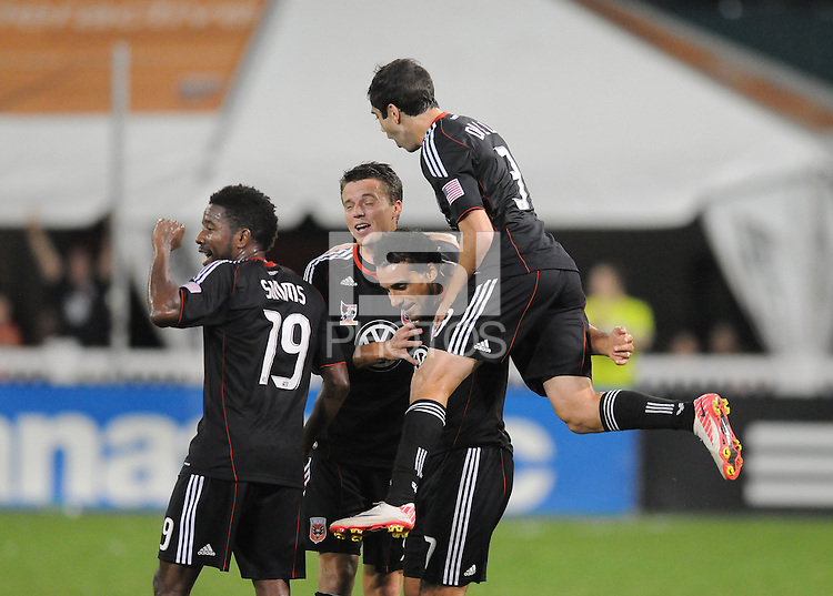 D.C. United forward Dwayne De Rosario (7) celebrates with teammate his third goal in the 31th minute of the game.  D.C. United defeated Real Salt Lake 4-0 at RFK Stadium, Saturday September 24 , 2011.