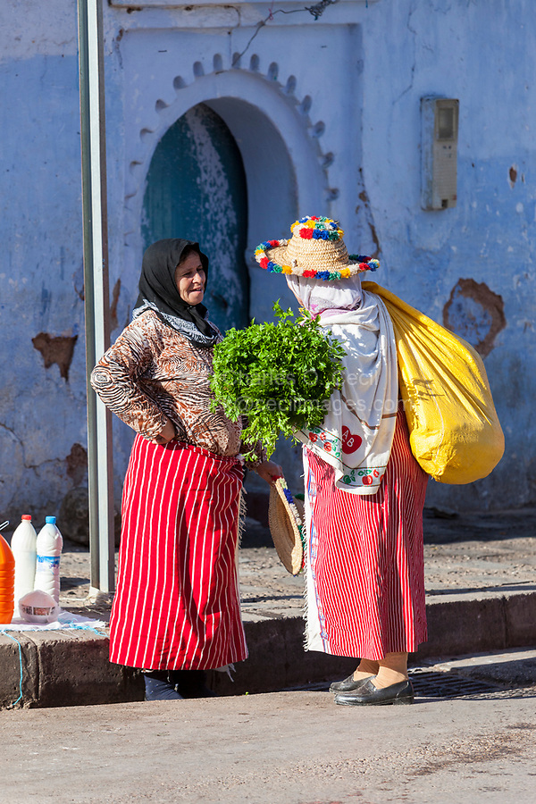 Chefchaouen, Morocco.  Two Berber Women Talking on the Street.
