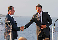 French President, Francoise Hollande shakes the hand at Matteo Renzi , prime minister of Italy, during at press conference  on board of Itally's Navy Garibaldi, at the of Italy - France - Germany summit in Ventotene Island 22 August 2016