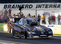 Aug 15, 2014; Brainerd, MN, USA; NHRA funny car driver Alexis DeJoria during qualifying for the Lucas Oil Nationals at Brainerd International Raceway. Mandatory Credit: Mark J. Rebilas-