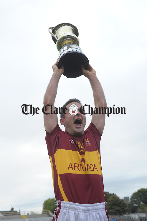 Brian Curtin, captain of Miltown, lifts the cup following the win over Cooraclare in the county senior football final at Cusack park. Photograph by John Kelly.