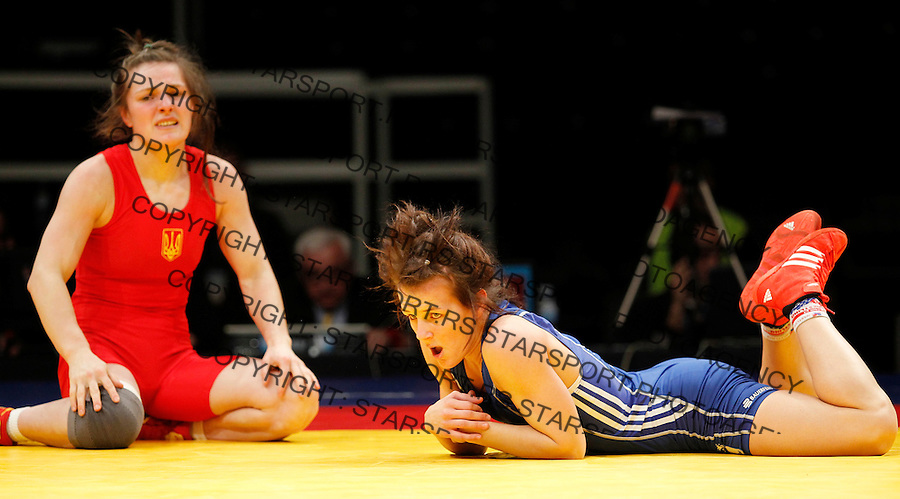 BELGRADE, SERBIA - MARCH 06: Jaqueline Saskia Schellin of Germany (R) reacts after lost the match against Lyudmyla Balushka of Ukraine (L) in the Woman's Freestyle 48kg during the European wrestling championship March 06, 2011 in Belgrade, Serbia.(Photo by Srdjan Stevanovic/Getty Images)