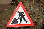 Men at work red triangle road sign